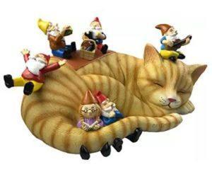 outdoor garden gnomes on sleeping cat