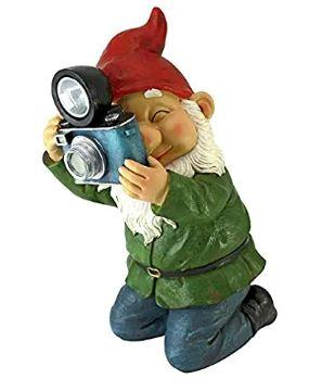 Solar gnome with camera with flash bulb